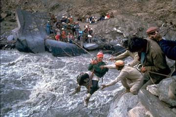 Crossing the Ghuzherav River at War-e-Ben, Shimshal, 1991